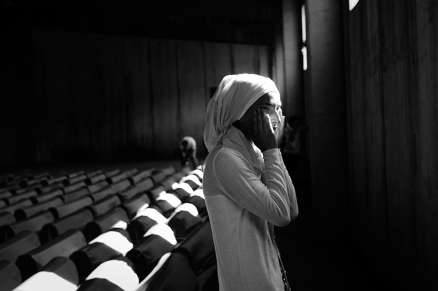 """A girl mourns her father killed in the Srebrenica massacre Every year the 11th of July a sea of coffins lined up for the funeral in the small, used to be forgotten at-the-end-of-the-road town called Srebrenica in eastern Bosnia. The international criminal court said the most terrible crimes of genocide on European soil since the Second World War were committed in Srebrenica area when the Bosnian Serb forces massacred more than 8000 of Muslims after the enclave, ironically under U.N. protection as a safe heaven, was overrun by an army led by its ruthless commander; General Ratko Mladic. On may 2011, after more than 15 years on the run Mladic was captured in a small village in Serbia and he joins Radovan Karadzic, his war-time president and another """"butcher of Balkans"""", in the Hague. Over 4.000 body bags are still in a cold store, waiting to be opened and checked by the experts of ICMP (International Commission of Missing Persons), whose mission is to complete the bodies and identify them."""