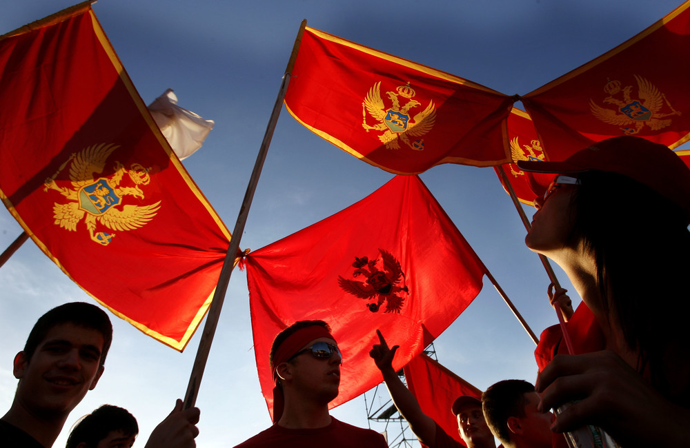 Montenegran 'YES' supporters (pro independence) gather on Thursday evening, in Podgorica, for a rally prior to Sundays referendum about whether Montenegro should part from Serbia. The red flag is the old flag of Montenegro. Picture by Peter Nicholls-The Times-19/05/06