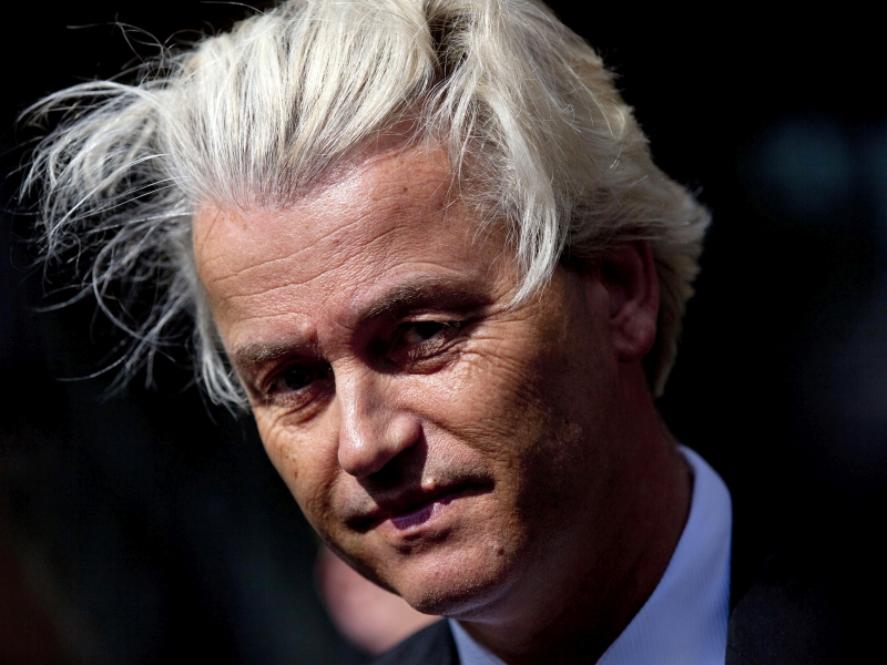 FILE - In this May 12, 2014 file photo Dutch lawmaker Geert Wilders pauses, as he speaks to journalists outside the Dutch National Bank in Amsterdam. A Dutch court said Friday Dec. 9, 2016 that populist anti-Islam lawmaker Geert Wilders is guilty of hate speech charges. (AP Photo/Peter Dejong, File)