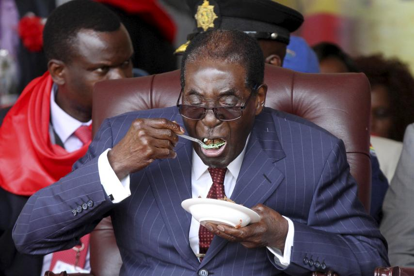 zimbabwe-president-robert-mugabe-eats-cake-his-92nd-birthday-celebrations.