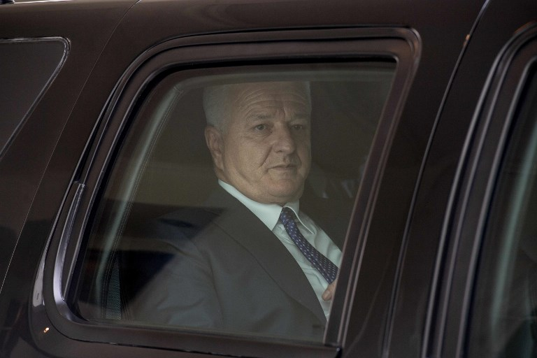 Montenegrin Prime Minister Dusko Markovic drives off in his car after talks with US Vice President Mike Pence at the White House in Washington, DC, on June 5, 2017. Montenegro became NATO's 29th member on June 5, 2017. / AFP PHOTO / NICHOLAS KAMM