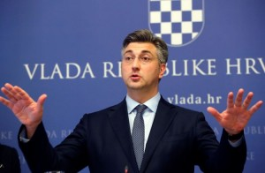 epa05943676 Croatian Prime Minister Andrej Plenkovic gestures during a press conference after Finance Minister Zdravko Maric survived a no-confidence vote, in Zagreb, Croatia, 04 May 2017. According to reports, 75 members of the Croatian parliament voted against Finance Minister Zdravko Maric, missing the 76 votes needed.  Prime Minister Andrej Plenkovic on 27 April dismissed three ministers from his coalition partner 'Most' (Bridge) party in a disagreement over the future of finance minister who the opposition are demanding his resignation.  EPA/ANTONIO BAT